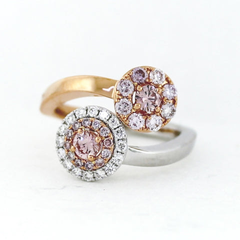 1 Round Brilliant Fancy Pink Diamond = .19ct GIA 1 Round Brilliant Fancy Pink Diamond = .17ct GIA and 20 Round Brilliant Fancy Pink Diamonds = .51ct 16 Round Brilliant White Diamonds = .20ctw 6.33gr Two Tone 18K Gold Ring LR3960
