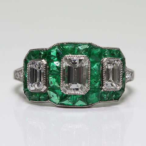 1 Emerald Cut Diamond = 0.60ct 2 Emerald Cut Diamonds = 0.45ct Emerald Accents 3.2gr Platinum Ring LR3963