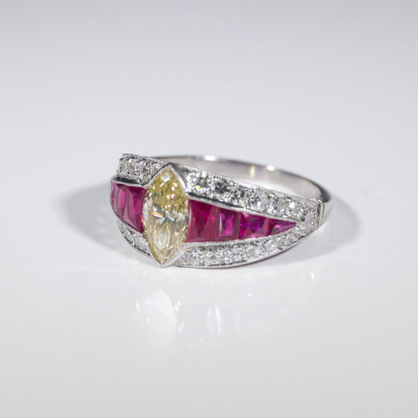 1 Marquise Cut Diamond = 1.05 Round Diamonds = .70ctw Ruby Accents 4.5gr Platinum Ring LR4005