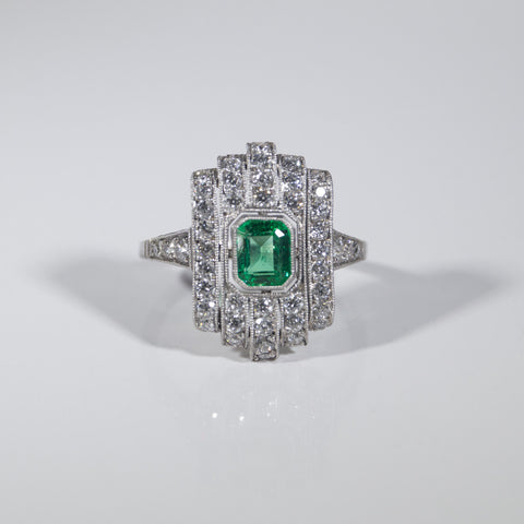 1 Emerald Cut Emerald = .71ct Round Diamonds = .96ctw 4.4gr Platinum Ring LR4009