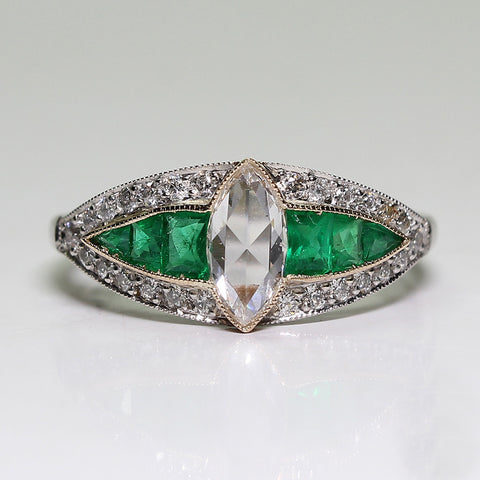 1 Marquise Cut Diamond = 0.38ct Round Diamonds = .30ctw Emerald accents 4.1gr Platinum and 18K Gold Ring LR4010