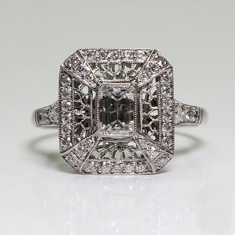 1 Emerald Cut Diamond = 0.40ct F VS1 Round Diamonds = .45ctw 3.5gr Platinum Ring LR4026