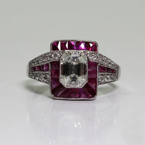 1 Emerald Cut Diamond = 0.97ct Round Diamonds = .50ctw Ruby Accents 4.8gr Platinum Ring LR4027