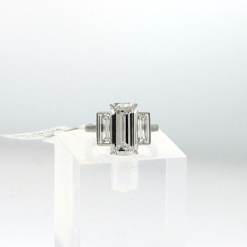 4.67 ct Emerald Cut E SI1 and 1 Baguette = 1.00 E IF, 1 Baguette =1.02 E VVS1 Platinum Ring GIA # 1152729082 DX0771 LRX0260