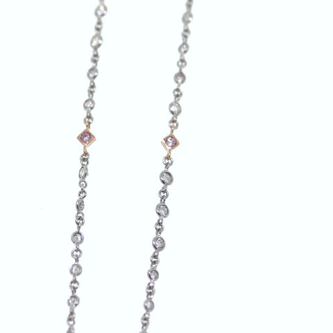 10 Round Brilliant = 0.18 Fancy Pink 69 Round Brilliant = 2.61 18 Platinum & 18K Gold Necklace NK2019