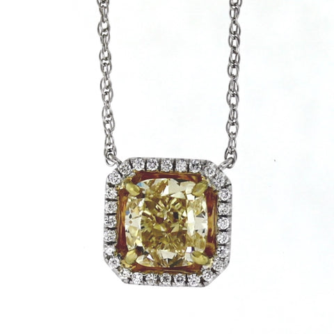 1 Cushion Cut Fancy Yellow Light VS1 Diamond = 3.01ct GIA28 Round Brilliant Diamonds = .17ctw 3.7gr 18