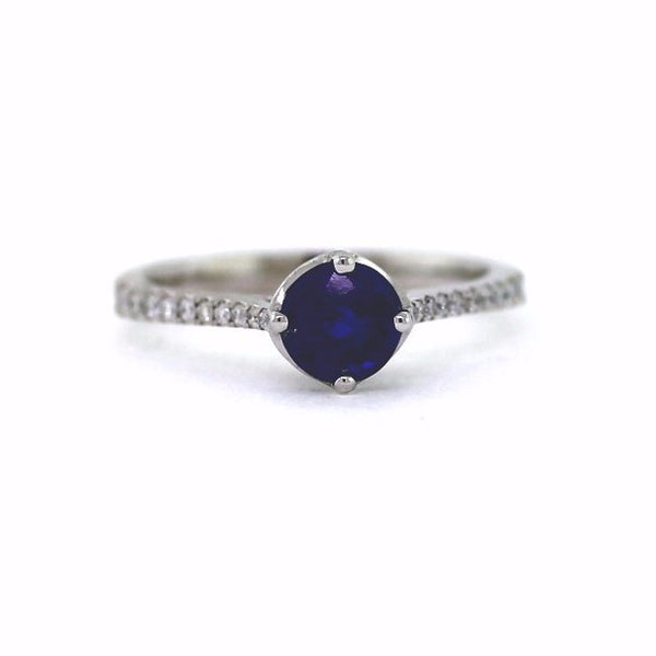 28 Round Brilliant = .18cts 1 Round Brilliant Blue Sapphire = 1.15 18K White Gold Lady's Ring SMNT1471
