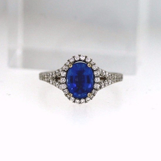 74 Round Brilliant = .50 1 Oval Sapphire = 1.47 18K White Gold Lady's Ring LR0764