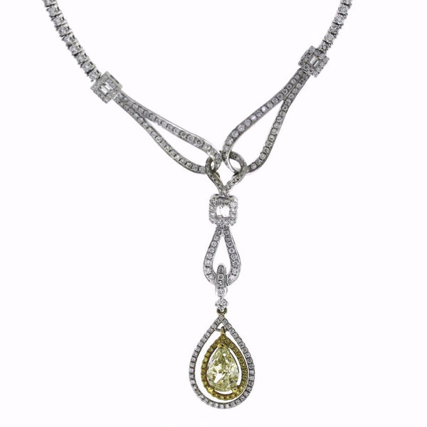 269 Round Brilliant = 6.07 6 Tapered Baguette = .16 1 Pear Shape = 2.74ct Fancy Yellow Light SI2 27.94gr 18K White Gold Necklace NK1733