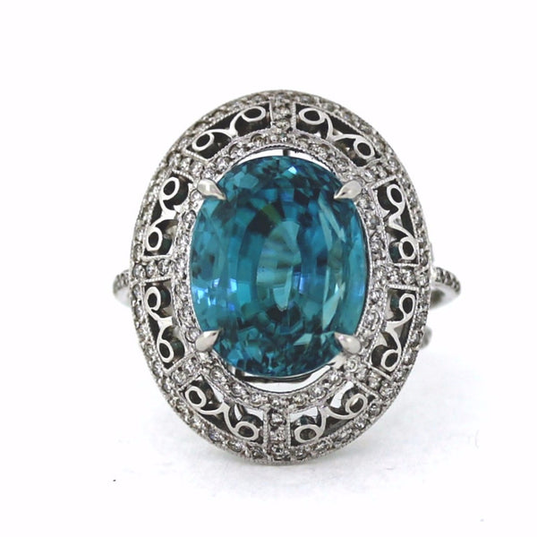 164 Round Brilliant = .75ctw 18.00 Oval Blue Zircon Platinum Lady's Ring SMNT1764
