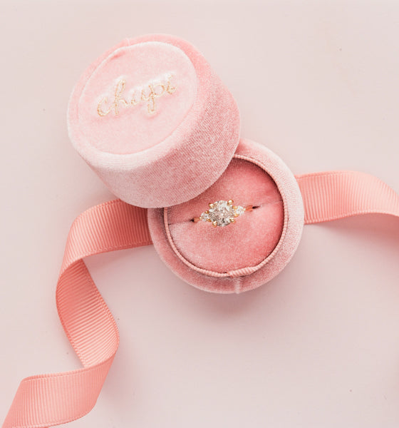 An engagement ring in a Chupi box