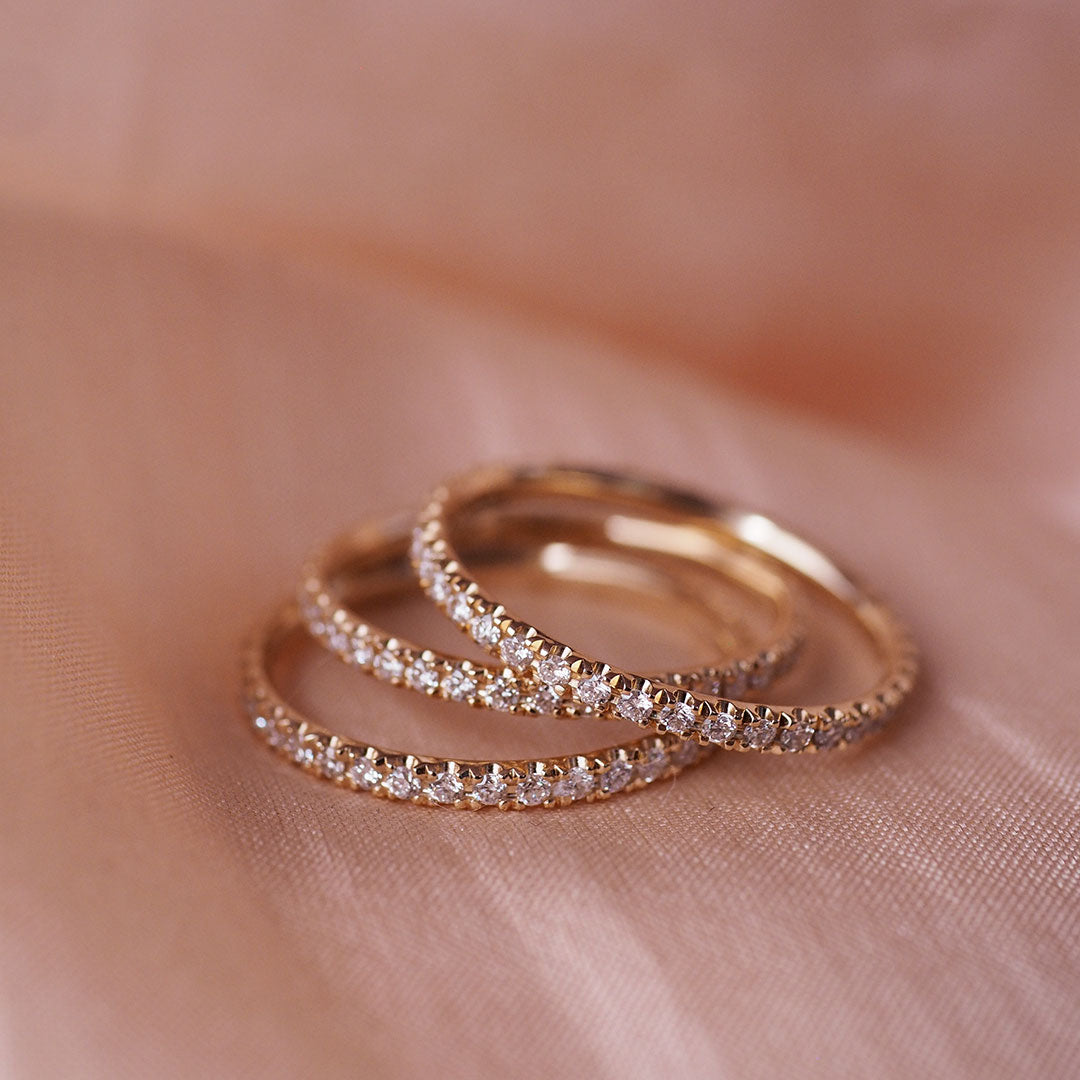 Image of gold Chupi eternity rings