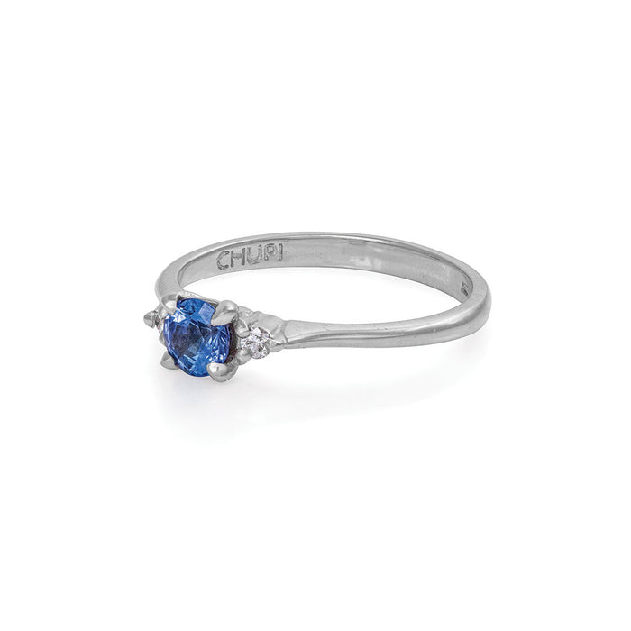On-body shot of Solid White Gold Love Is All - Blue Sapphire & Diamond Polished Band Ring