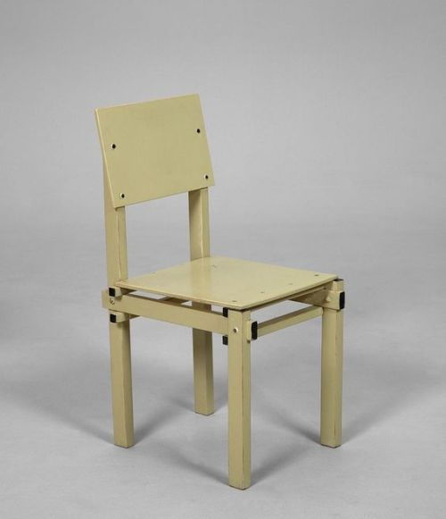 Military 1 chair by Gerrit Rietveld. Lacquered Wood. Ca. 1950's.