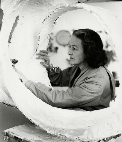 Barbara Hepworth with Oval Form (Trezion) 1963 in the Palais studio 1963 © Bowness, Hepworth Estate Photo: Val Wilmer