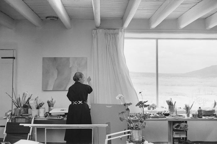 O'Keeffe opening the curtains of her studio, 1960 — Georgia O'Keeffe Museum