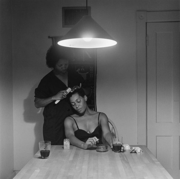 Untitled (Woman Brushing Hair) — The Kitchen Table Series, 1990