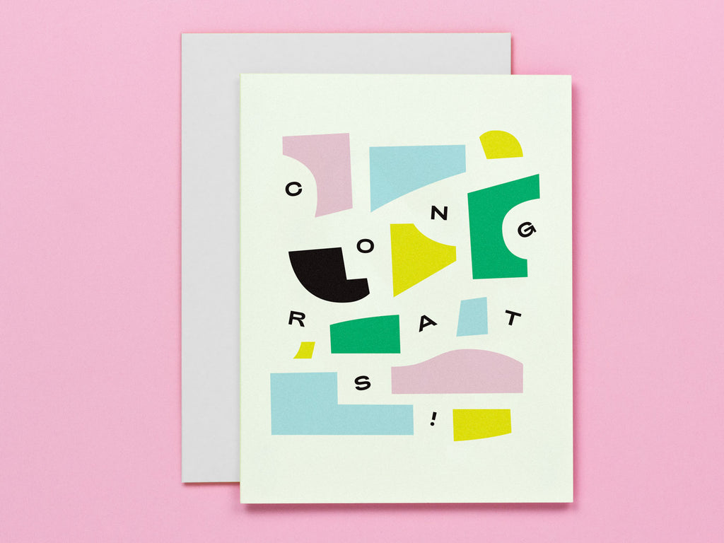 Congrats card featuring a composition of abstract pieces and shapes and falling typography. Made in USA by My Darlin' @mydarlin_bk