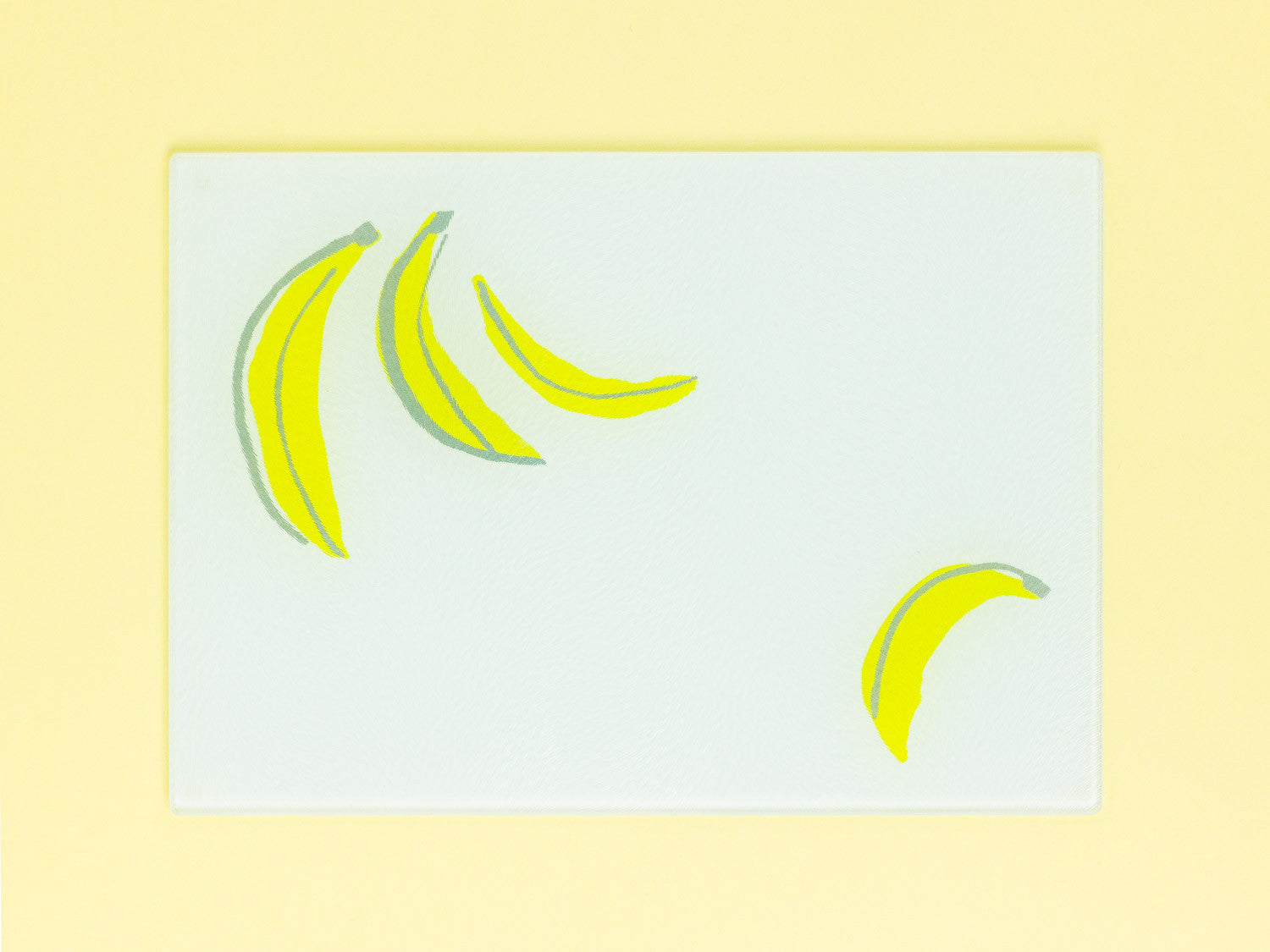 Floating Bananas Tempered Glass Cutting Board