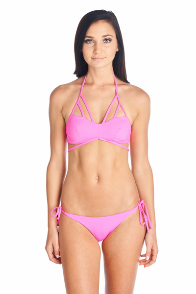 Hot Pink swimwear with multiple straps and hardware on back