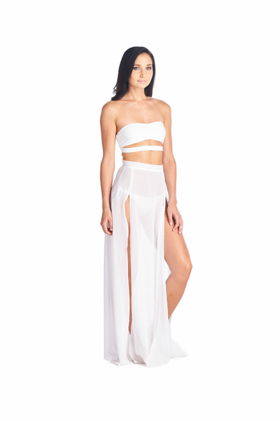 Side view of the Akemi skirt in white by Aikido Swimwear worn by Khloe Kardashian. Accompanied by out strapless Hana swimwear top