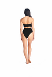 Back view of the Aikido Swimwear Toro halter top in black with high waisted Hikari eyelet bottoms