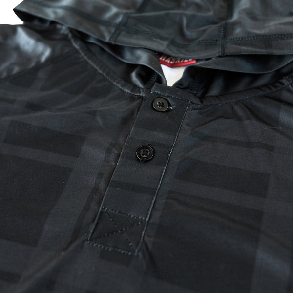 closeup of Haskill black plaid baselayer for skiers