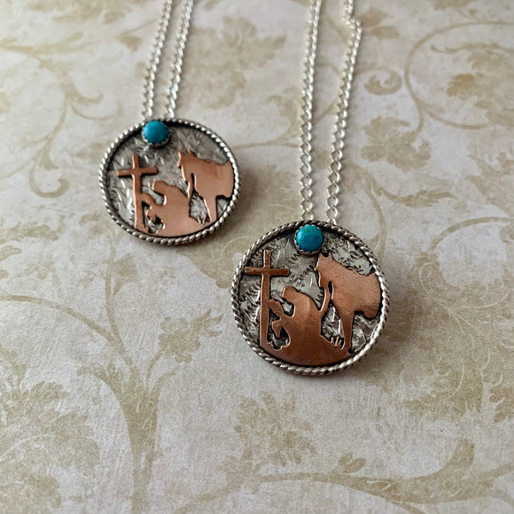 1 1/8 Round Sterling silver with cowboy with his horse at the cross copper cutout