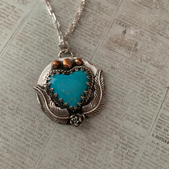 Kingman Turquoise Heart Sterling Silver Necklace with a beautiful tiny rose.
