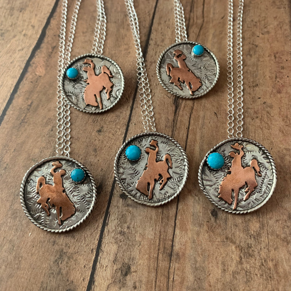 1 1/8 Round Sterling silver with Bronc rider cross copper cutout