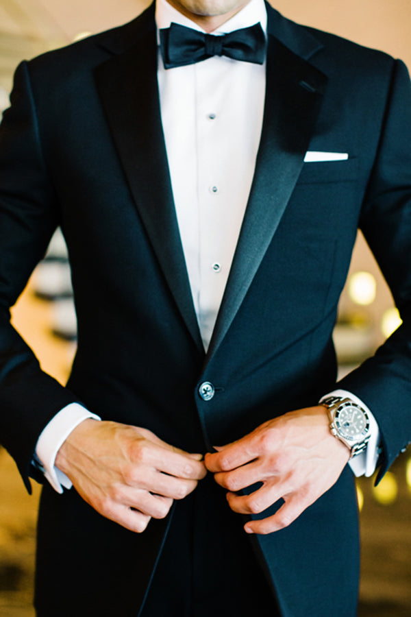 Groom and his tuxedo with cufflink shirt