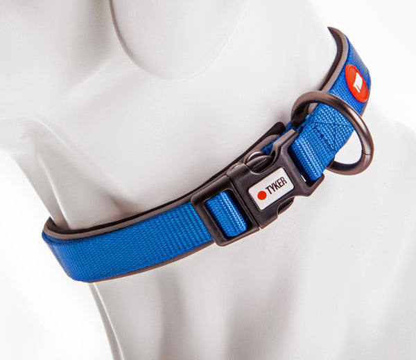 close up of dog mannequin's neck wearing a blue dog collar with reflective piping, tyker branded clip and metal ring