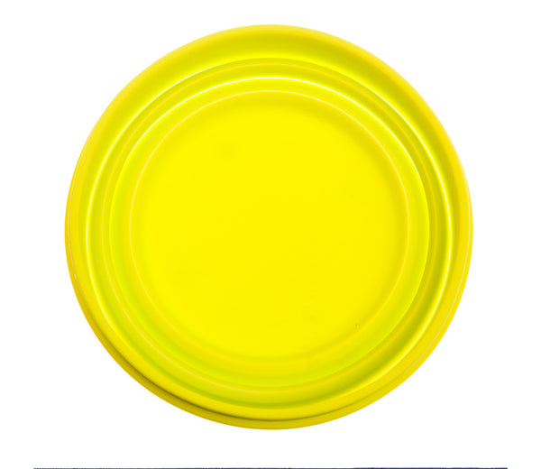 folded yellow collapsible travel dog bowl