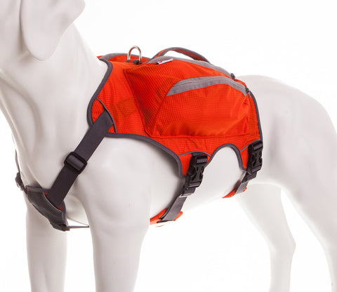dog mannequin wearing a orange high visibility dog saddlebag with reflective piping and tyker logo