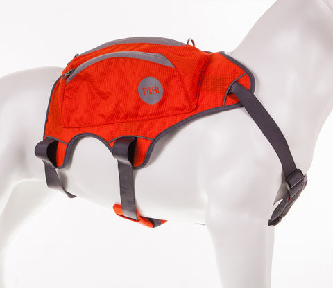 image of a dog mannequin wearing a orange high visibility dog saddlebag with reflective piping and tyker logo