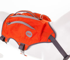 left side of a dog mannequin wearing a orange high visibility dog saddlebag with reflective piping and tyker logo