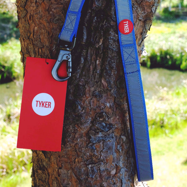 blue reflective lead with red and whote round tyker logo, metal clip and red square label