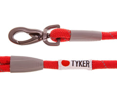 close up of red rope dog leash with tyker logo and metal clip