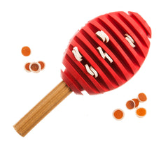 red rugby shaped dog ball feeder toy filled with treats