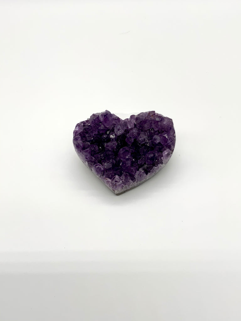 Deep purple amethyst cluster in center of picture