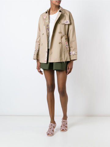 Beige cotton embroidered trench coat.