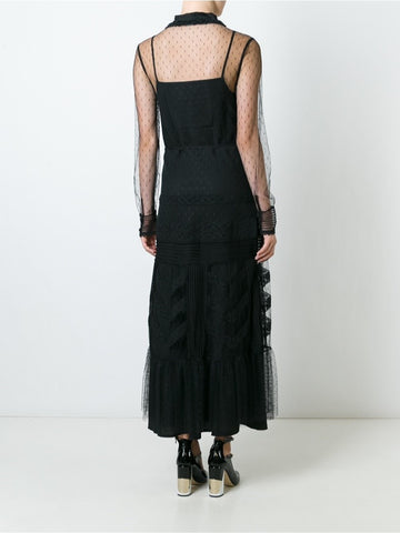 Black embroidered tulle dress.