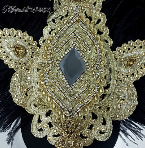 Detailed bejewelled ostrich feather headpiece