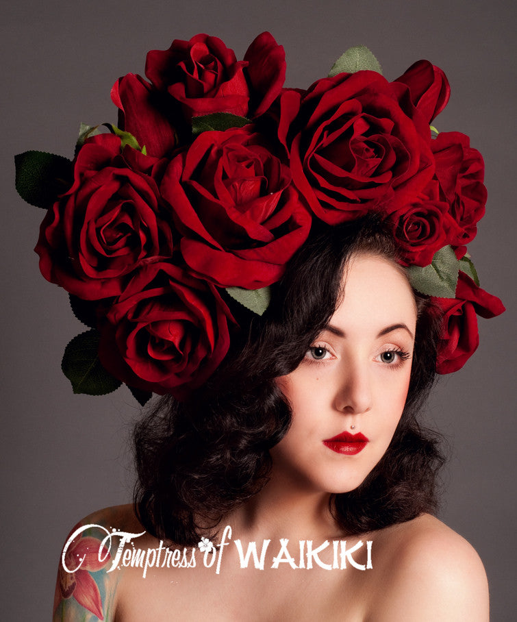 opulent giant red rose headdress, with many red velvet roses and leaves on a wide headband. Temptress of Waikiki is well known for producing the most fabulous flower crowns and flower headdresses