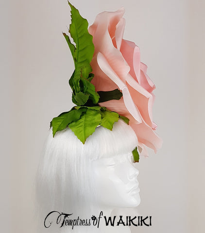 Huge rose headpiece, set on a wired sinamay fascinator base, covered in leaves.