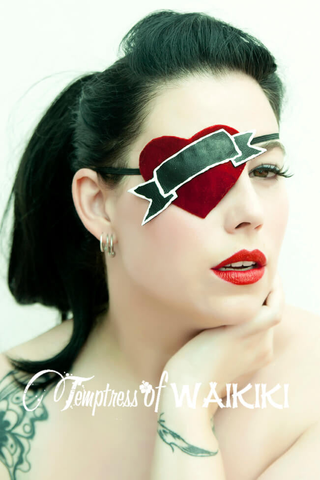 Red velvet tattoo style eye patch, featuring a red velvet heart with black leather scroll. This can be sold as seen or you can have your choice of word written in the scroll. (see the digitally written image to get the basic idea). Message me for your choice of word when placing the order.  This skull eye patch is made using a molded eye patch, it's backed with a smooth leatherette to make it more comfortable to wear and easy to clean.  Though my eyepatches are beautiful fashion statements, most ladies who wear my eyepatches use them for medical reasons so please be sure to let me which side you would prefer to wear it when purchasing. If you would rather the eyepatch wasn't see through this is not a problem. Just message me when you purchase.