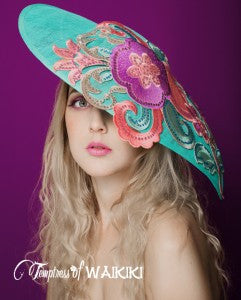 Royal Ascot hat in aqua blue and pinks, perfect for a wedding too.