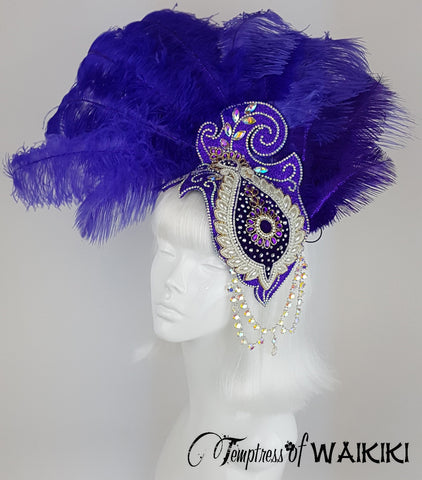 One of a kind, ornate purple glitter headdress.