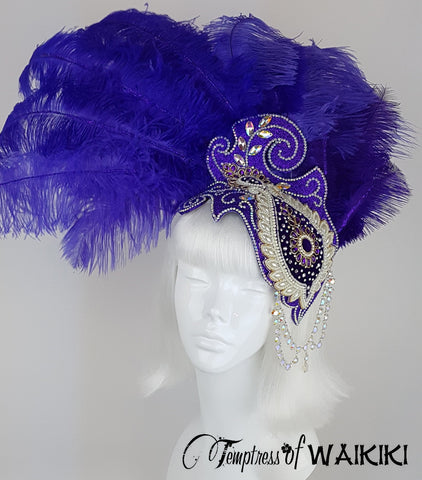 hand blocked hat, decorated with purple ostrich feathers, iridescent gems, pearls with rainbow iridescent jewels