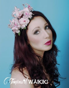 Pink, butterfly flower crown decorated with leaves. Attaches with a comb and adjustable hat elastic. This little crown is perfect for a bride or her bridesmaids, fairies and music festivals.